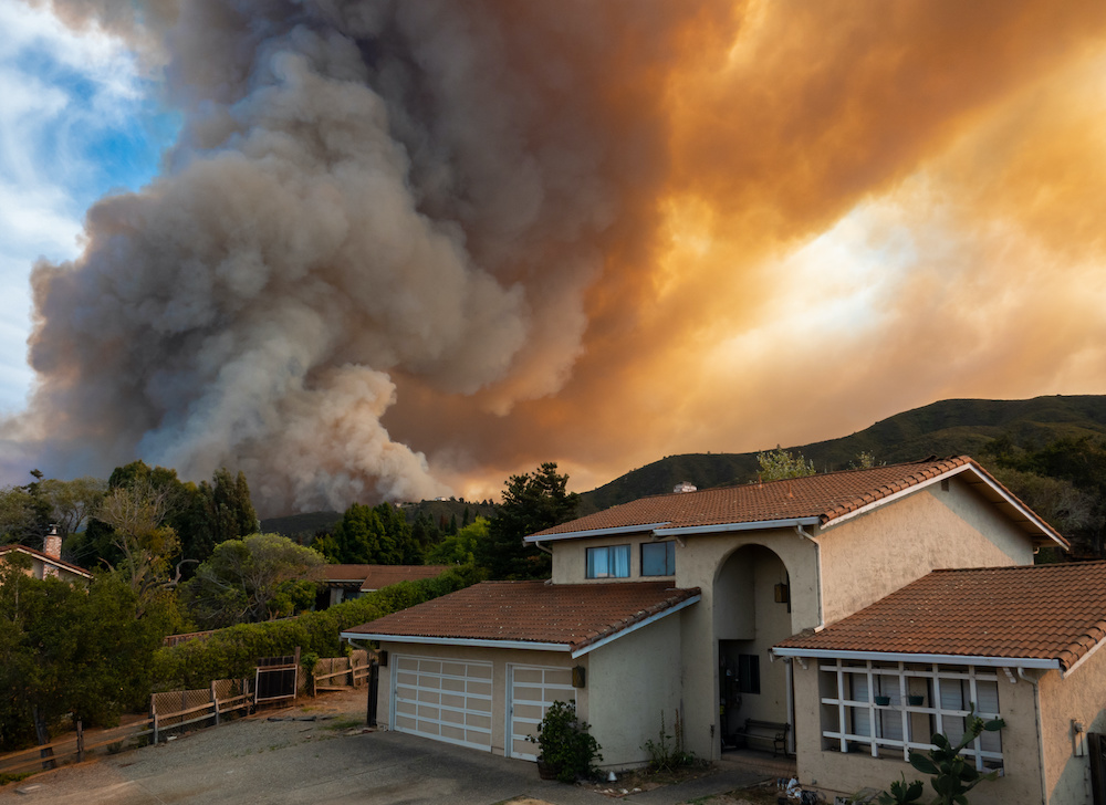 a home about to be destroiyed by a fire from a 2021 fire in california that wasn't protected by a precast fence